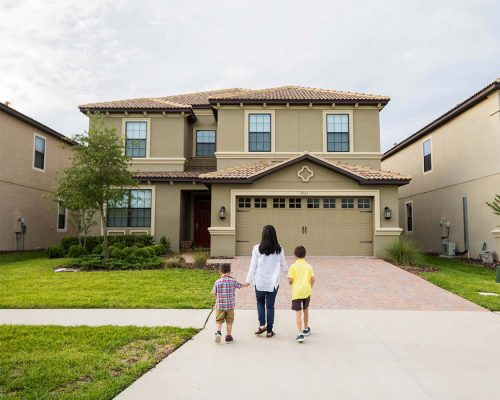 Family walking into a Kissimmee Vacation Home