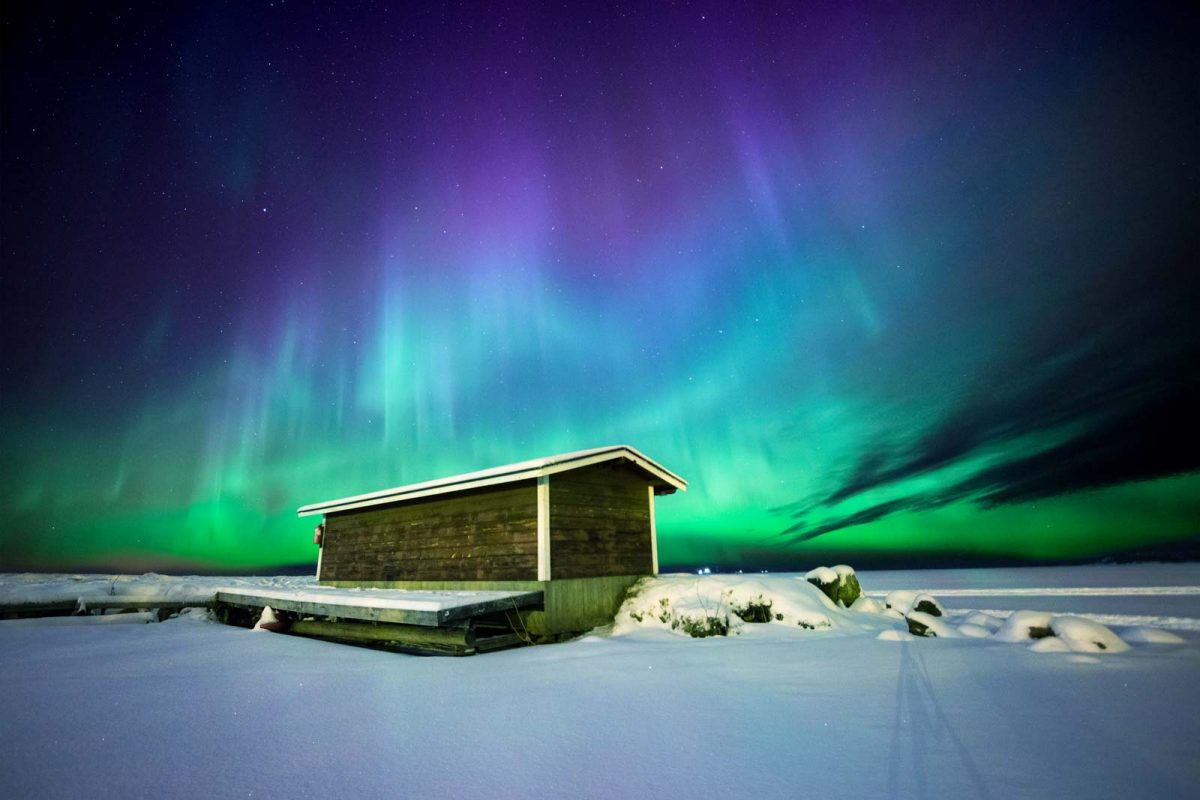 Fishing hut in Finnish Lapland against the Northern Lights