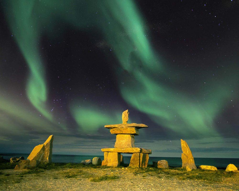 Northern Lights over Inukshuk in Churchill, Manitoba
