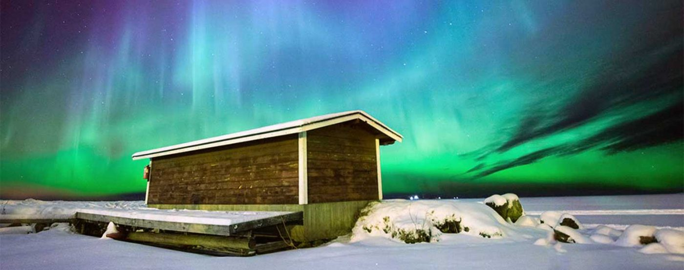 Fishing hut in Finland under the Northern Lights